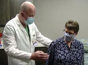 Dr. Nichols assessing patient